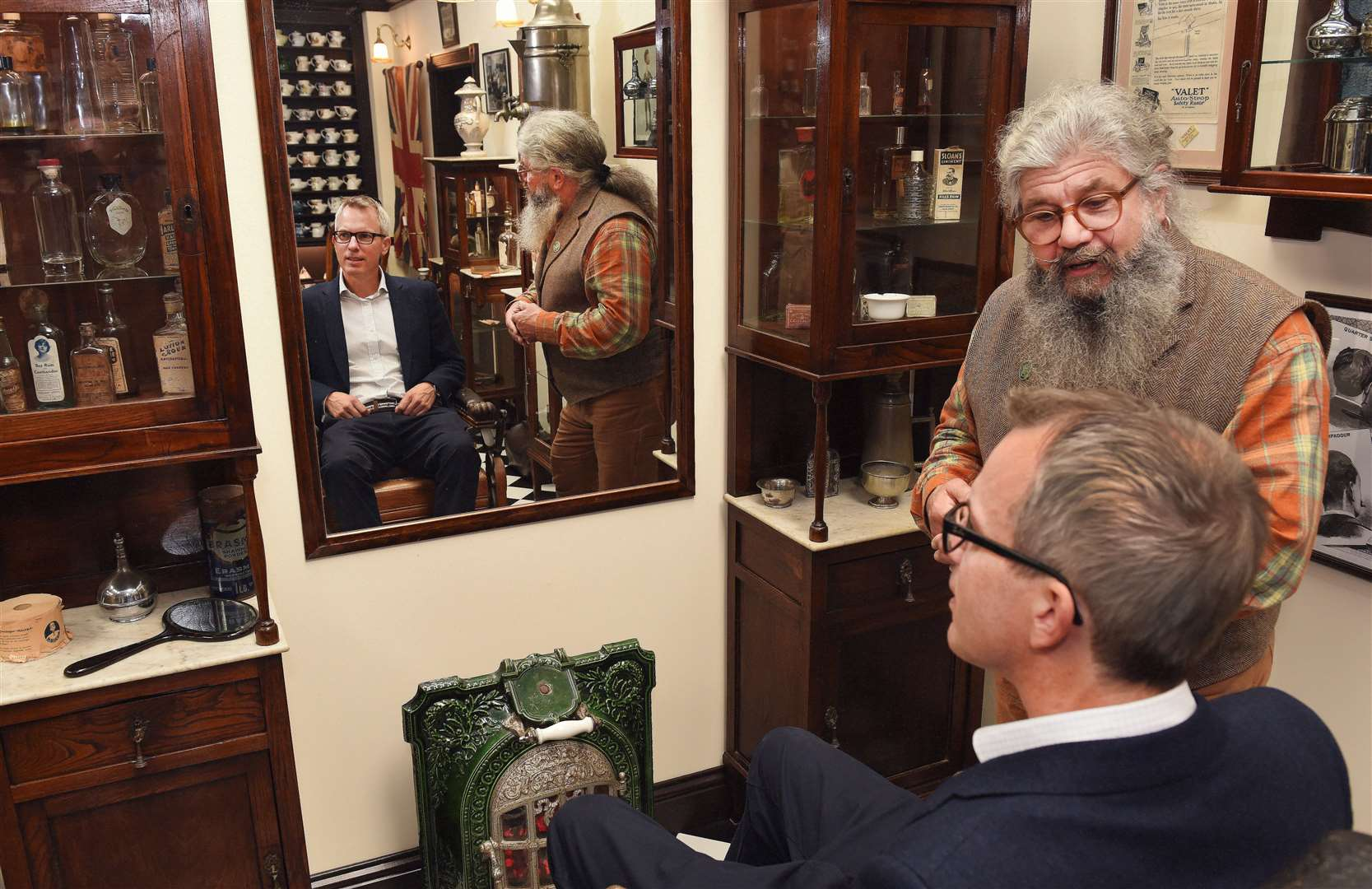 MP James Wild visiting Captain Fawsett's Emporium in King's Lynn..Richie Finney with MP James Wild and one of the museum displays. (52143711)