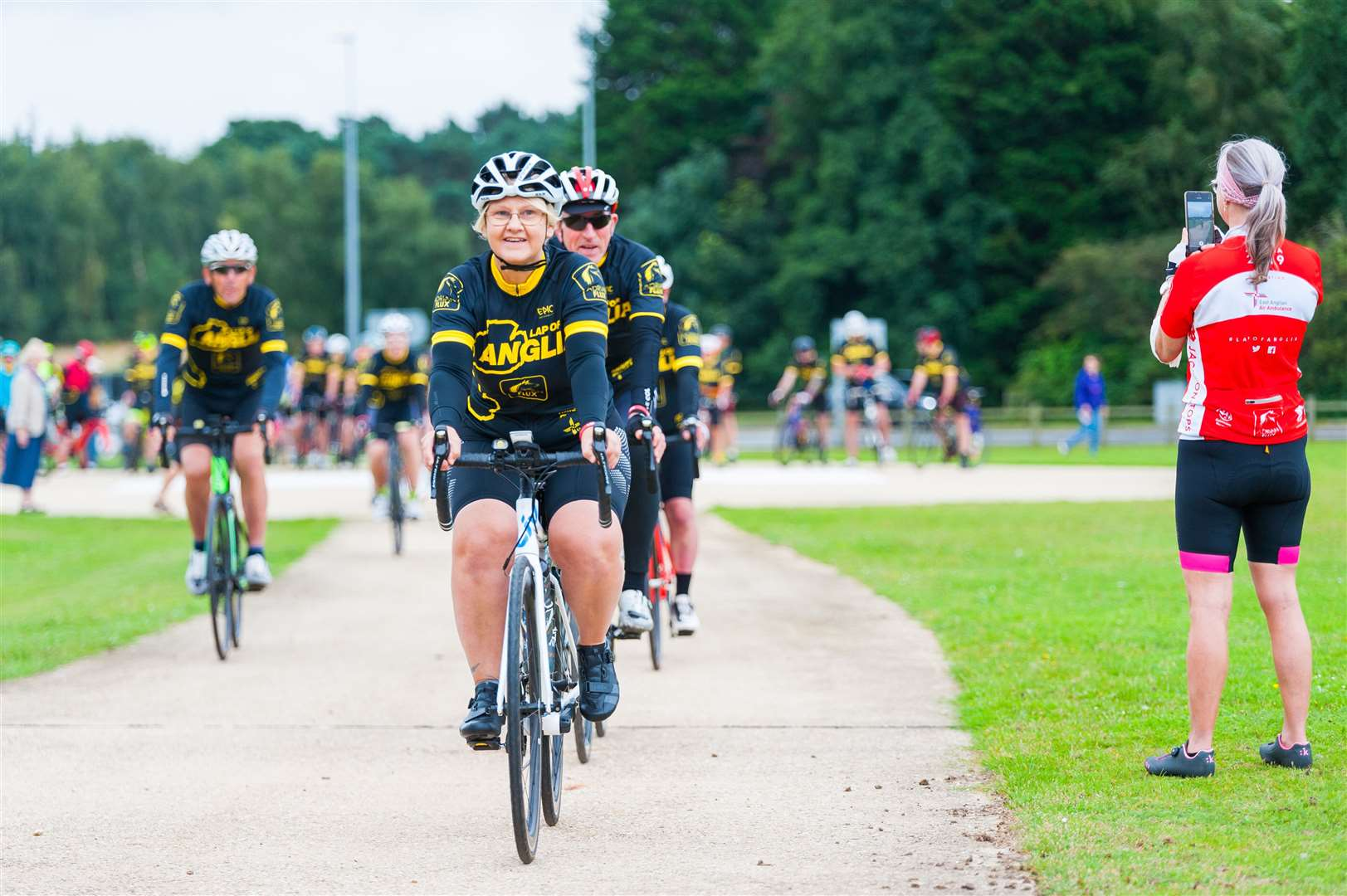The Lap of Anglia cyclists leaving the helipad at the QEH. (50337251)