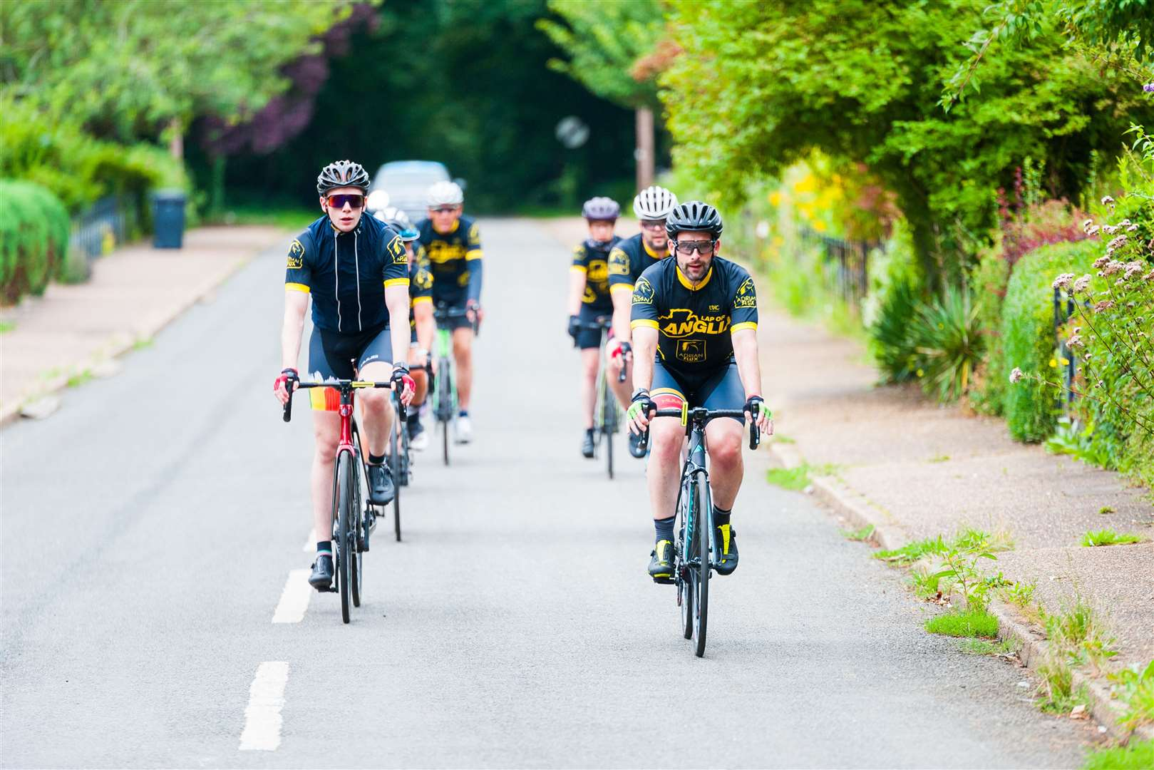 The Lap of Anglia cyclists heading through West Newton. (50337273)