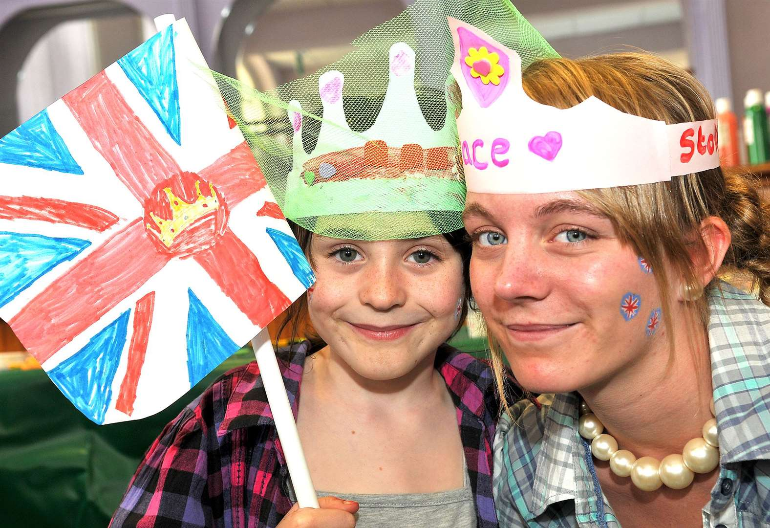 Royal wedding celebrations at Downham Market in the Town Hall. Khalin Heffernan (7) with 15 year old Grace Cawkwell, of the town youth council.. (46651545)