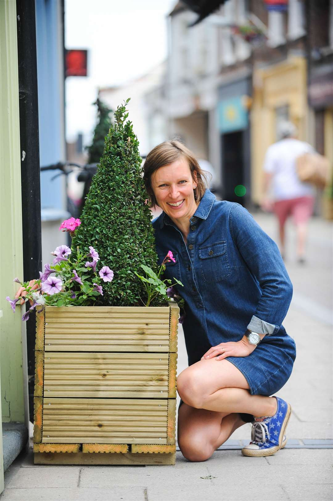 Vicky Etheridge with some of the new planters on Tower Street In King's Lynn.. (47992361)