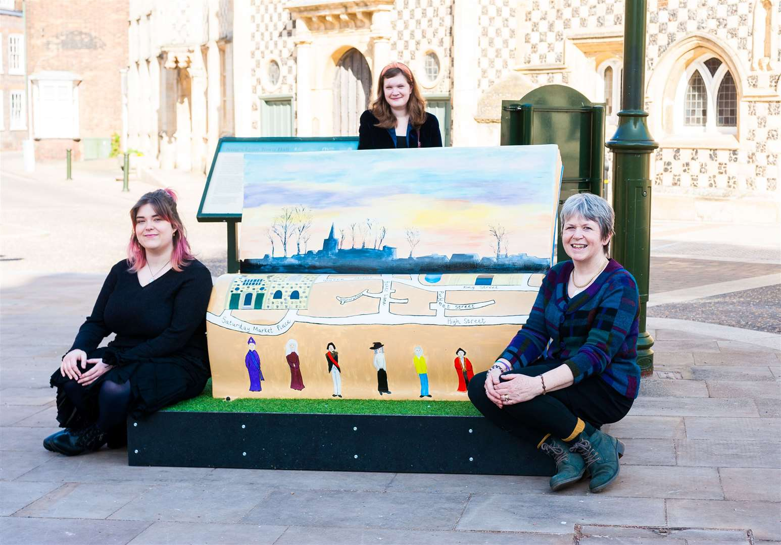 Artists (L) Savannah Andrews, Madeleine Eggleston and (R) learning and engagement officer, Rachael Williams at the the official launch of the Explore-a-book, a brand new book bench trail, in West Norfolk.. (45668934)