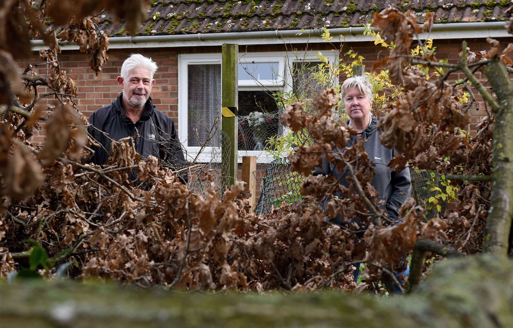 Part of a very large tree has fallen across the gardens of No 4 and No 2 Parkway in Gaywood. Pictured are residents Daryle Taylor (left) and Gill Taylor (right). Pictures: Paul Marsh