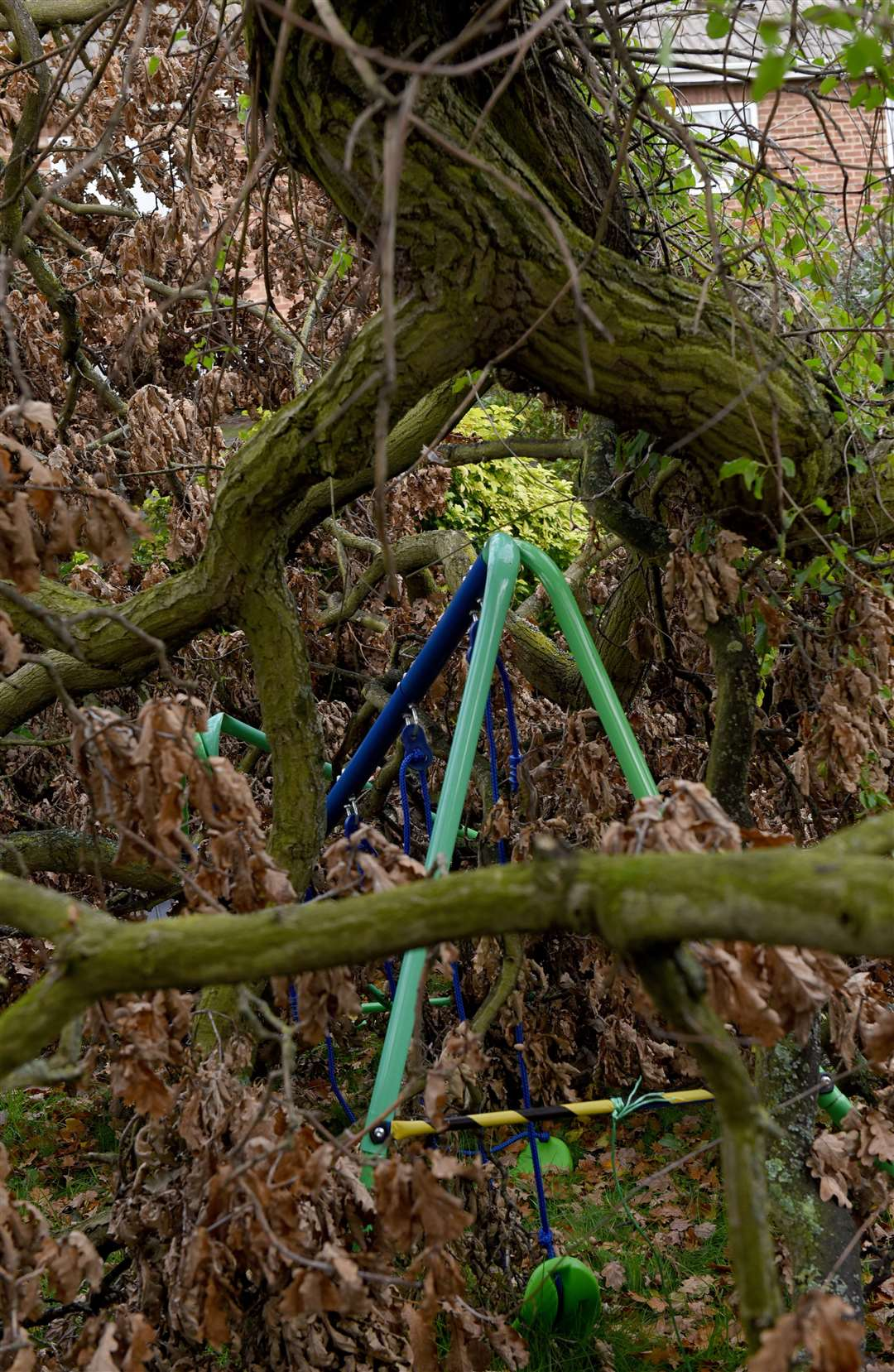 PPart of the play equipment that has been destroyed by the fallen tree in the garden of Daryle Taylor