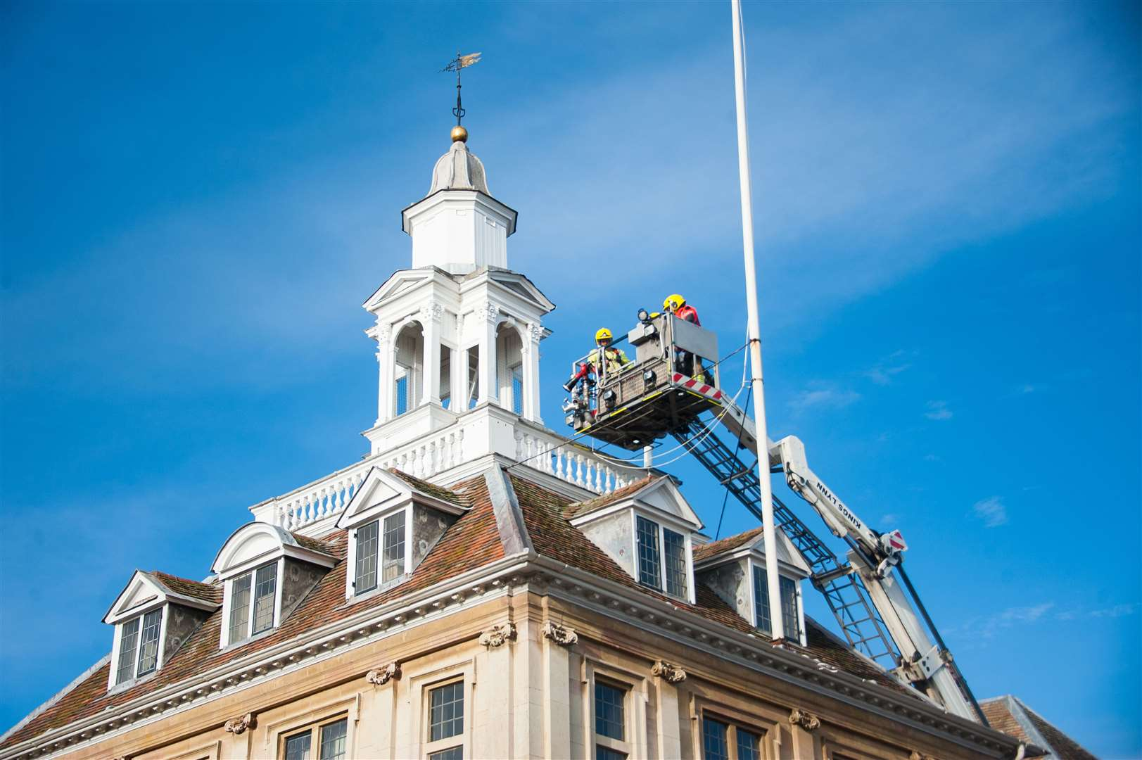 A King's Lynn fire crew using the aerial ladder platform, at the Custom House during a training exercise on Sunday.. (43233980)