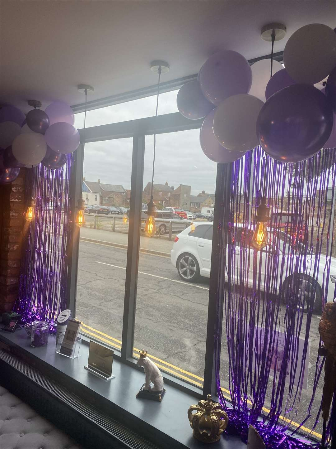 Purfleet Studio hair and beauty salon have a purple window display to highlight awareness of domestic abuse charity Pandora Project. (50799078)