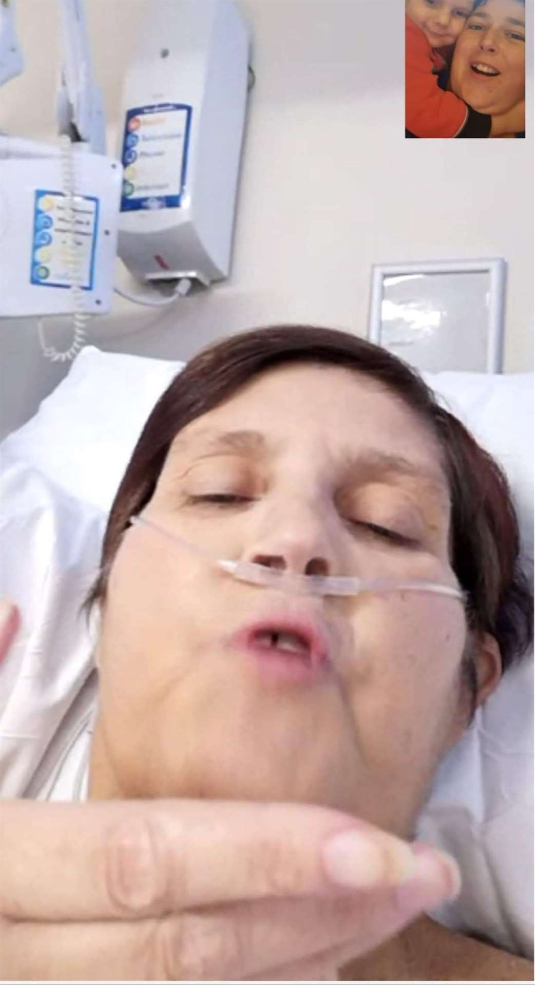 Sally Bailey, 58 on the QEH Covid Ward FaceTimes her family. Picture: SUBMITTED