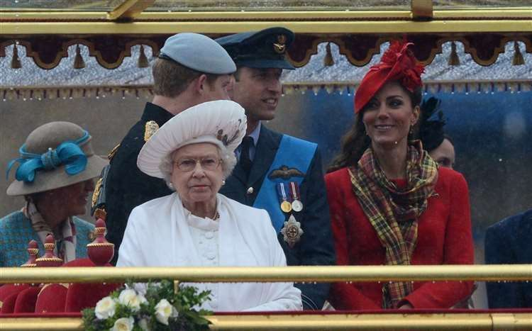 The Queen with the Duke of Sussex and the Duke and Duchess of Cambridge on the royal barge Spirit of Chartwell during the Diamond Jubilee River Pageant. Photo: Adrian Dennis/PA