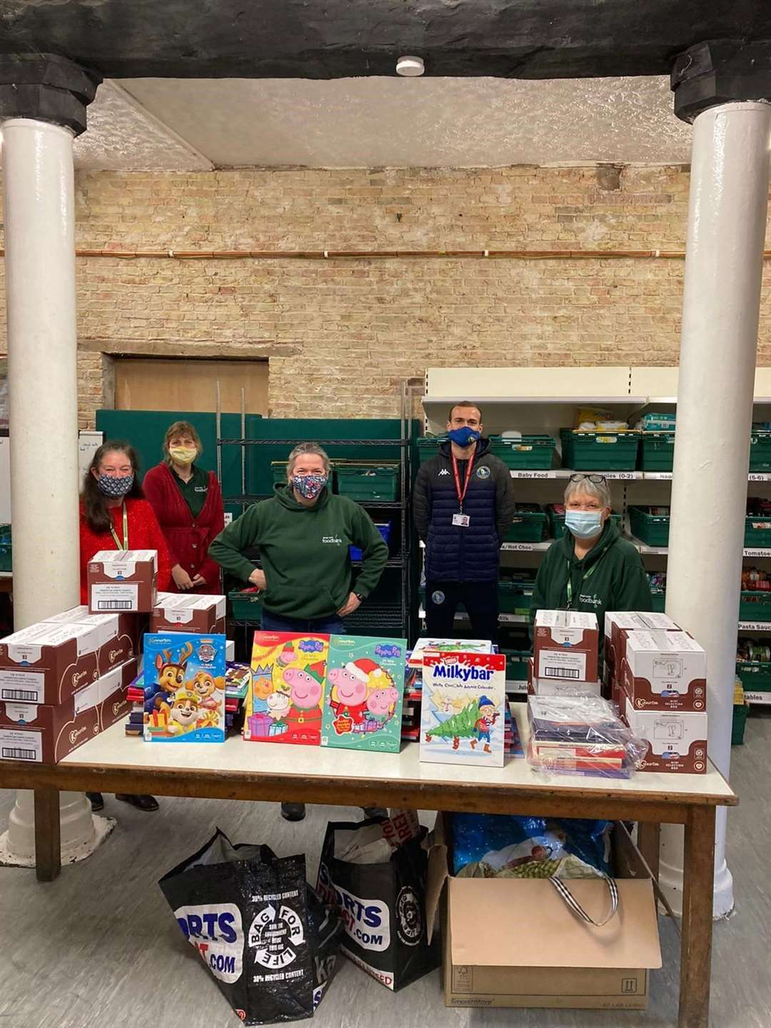 Staff from King's Lynn Foodbank with Joe Simpson, head of youth development at King's Lynn Town Football Club, who runs KES Academy Sixth Form's youth alliance programme, with donations of advent calendars. (43416837)
