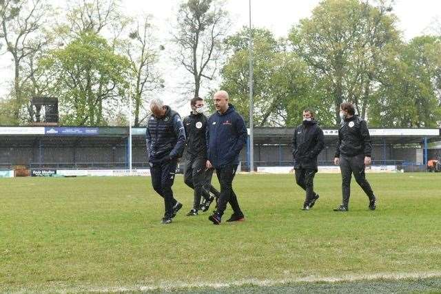 The management teams trudge off the sodden surface. Picture: Tim Smith. (46961478)