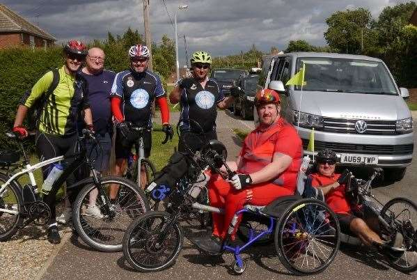 During the ride in August are (from left) Simon McCoy, John Adams (beneficiary), Karl Perryman, Mark Howard, Rob Womack and Philip Carter. (43023187)