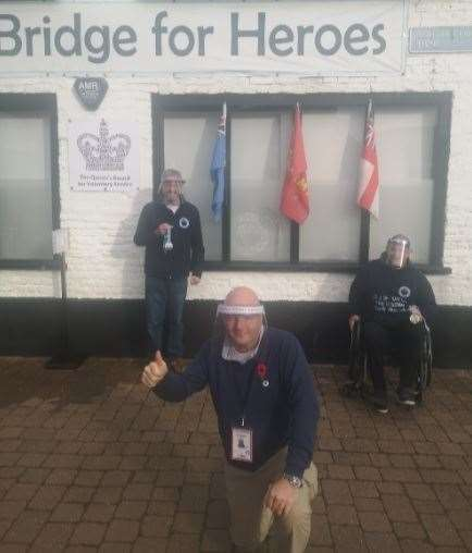 Karl Perryman (left) and Mark Howard received theri medals from (front) The Bridge For Heroes CEO Mike Taylor. (43023185)