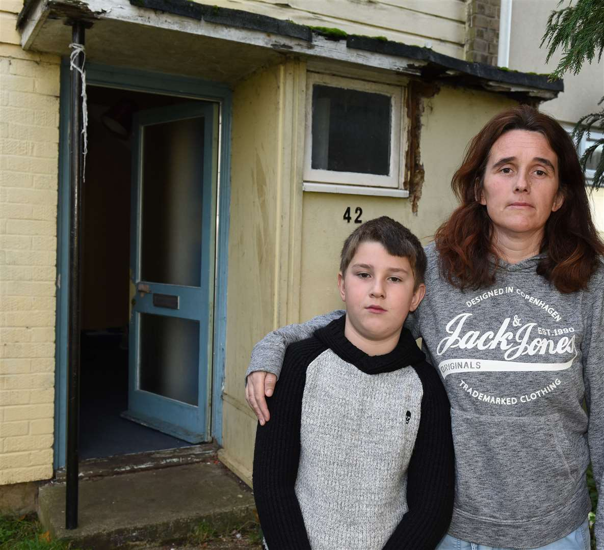 Kelly Peacock with her son Tomilee Croft outside her home. Picture: Paul Marsh