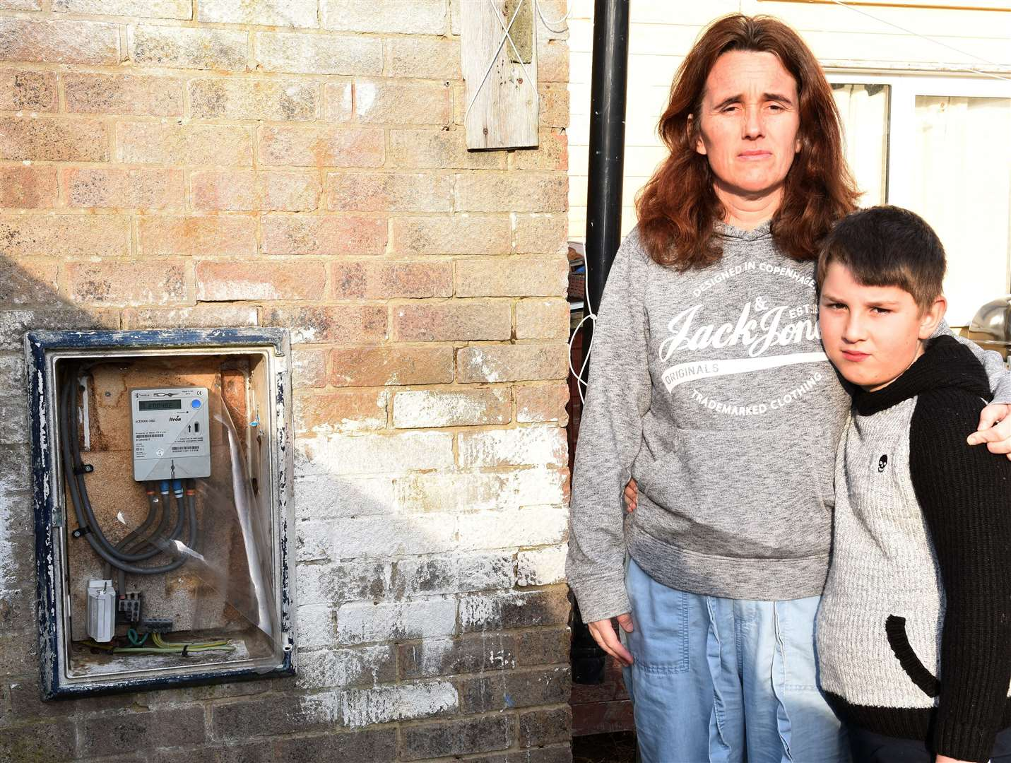 Kelly Peacock with her son Tomilee Croft (9) outside her home. Picture: Paul Marsh