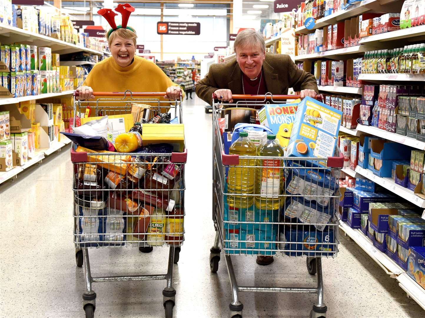 A trolley dash at Sainsbury's Hardwick Store King's Lynn, for The Purfleet Trust and the Winter Night Shelter with the Bishop of Lynn The Rt Revd Jonathan Meyrick and Cllr Lesley Bambridge in December 2018