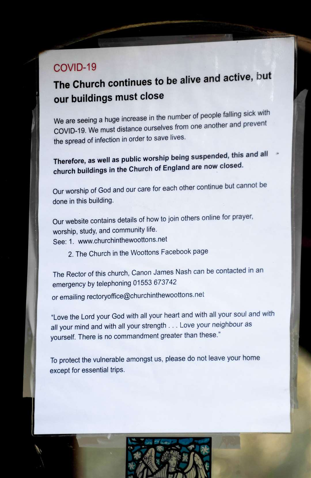 A COVID-19 notice in the window at St Mary's Church in the Woottons.. (43784494)