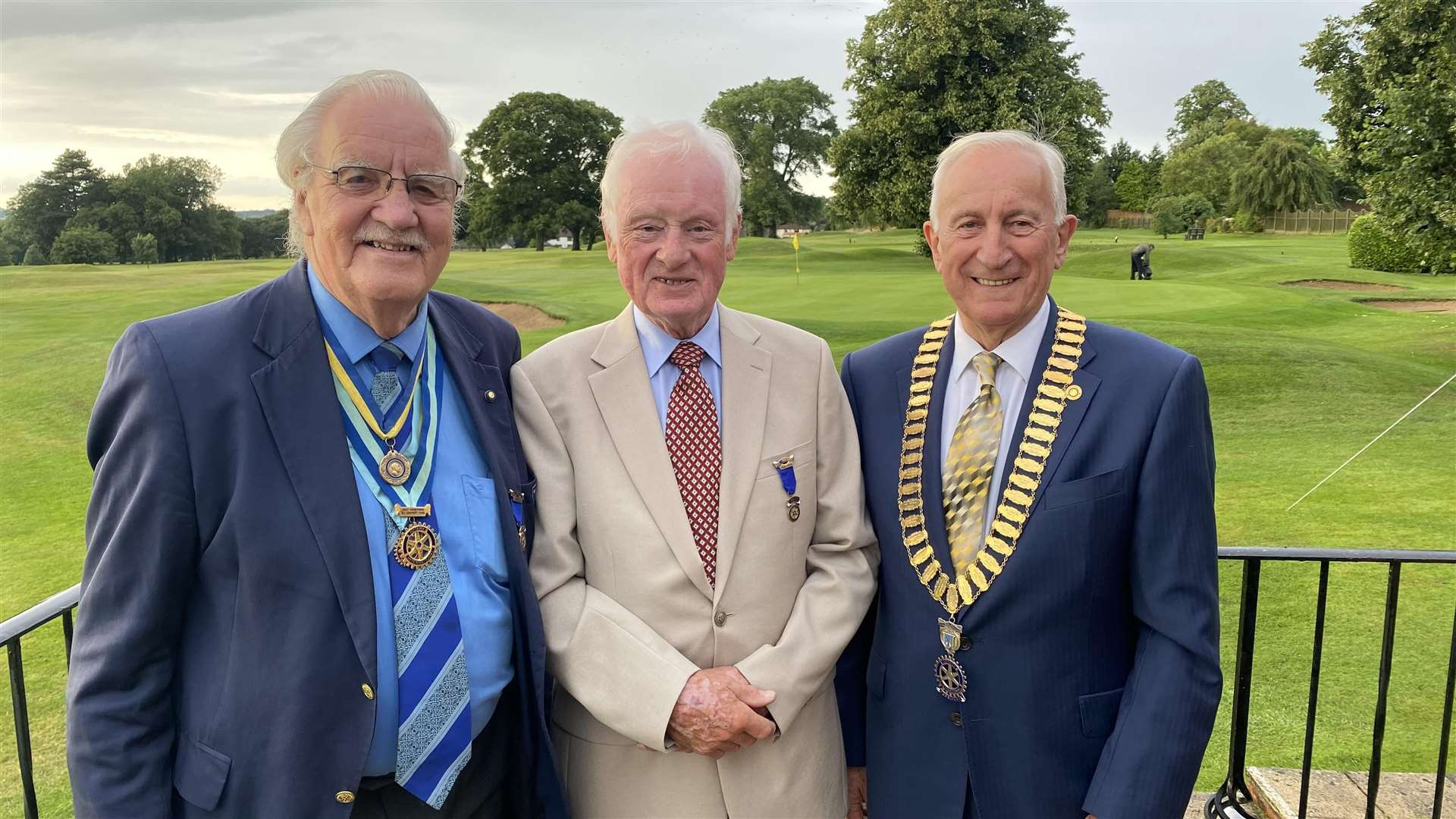 Peter Harris (left), hands over the chain of office to Ernie Foreman (centre) and John Thorpe.