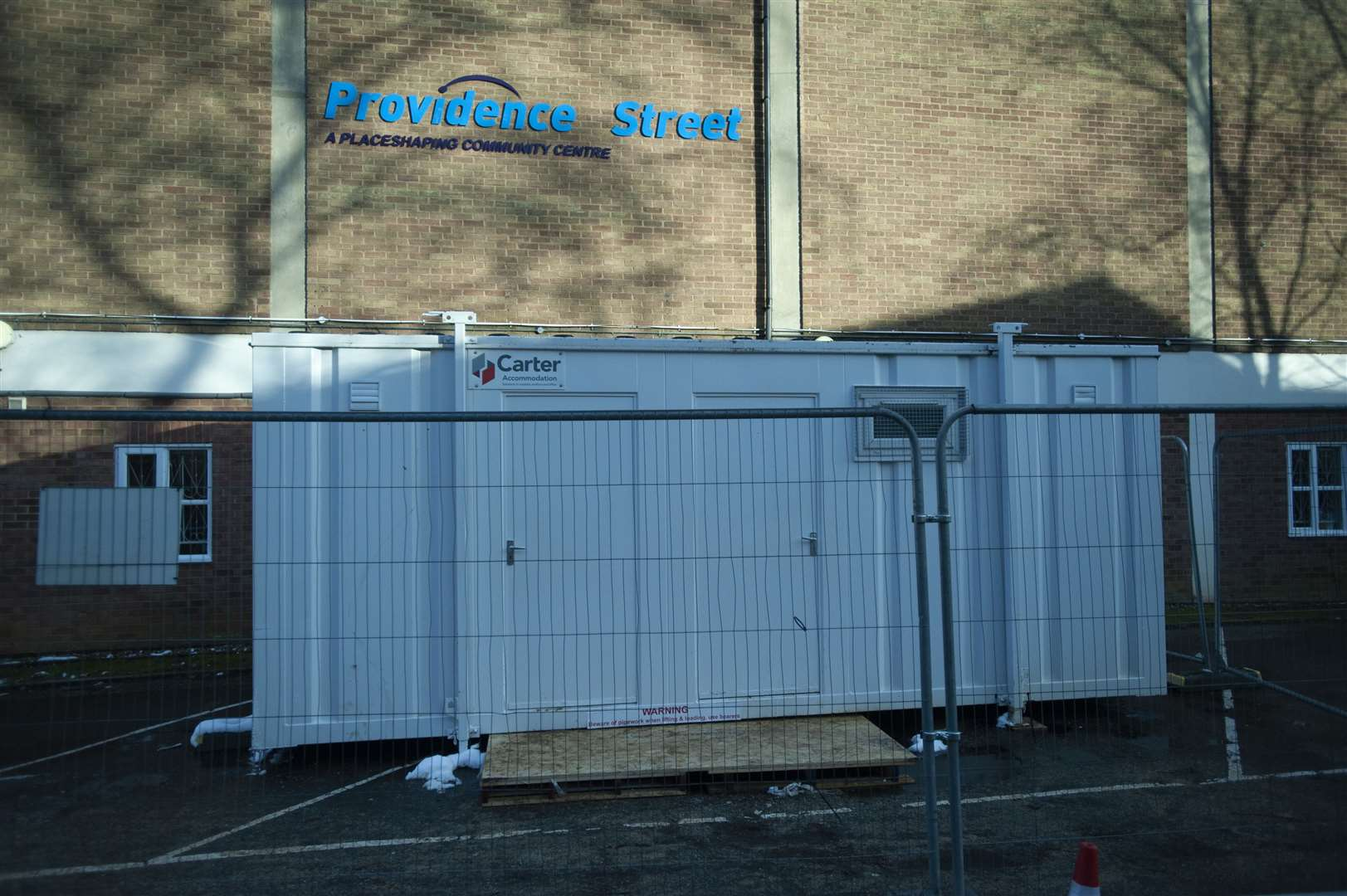 Temporary shower facilities have been set up at the Providence Street community centre.