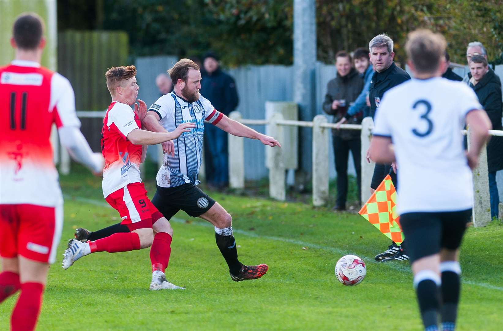 Dean Miller, pictured right in action for Swaffham Town FC, is raising funds for Prostate Cancer UK. Picture: Ian Burt