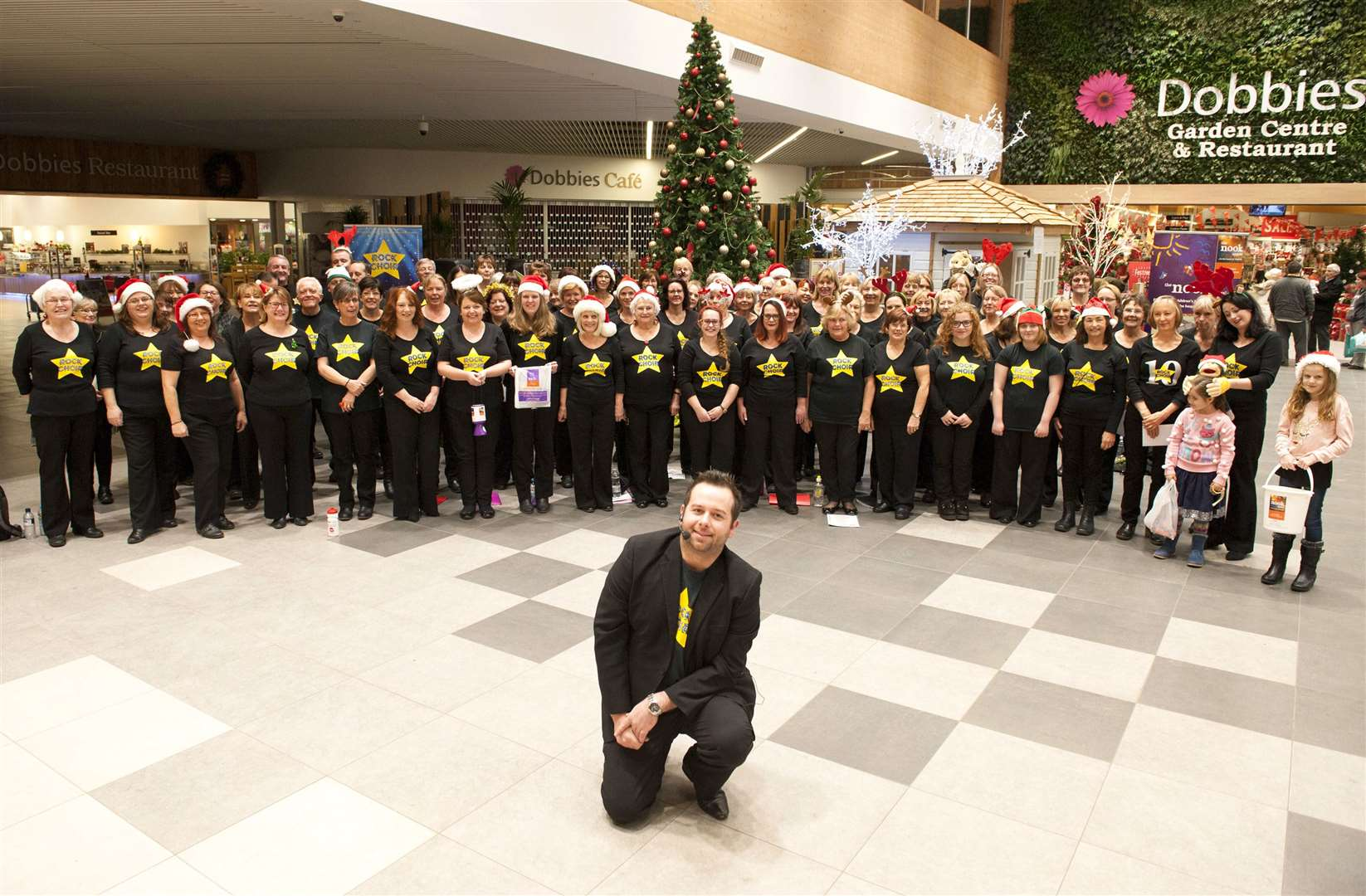 West Norfolk Rock Choir previously performing at Tesco Hardwick King's Lynn. Pictured is Mike Tandy with choir