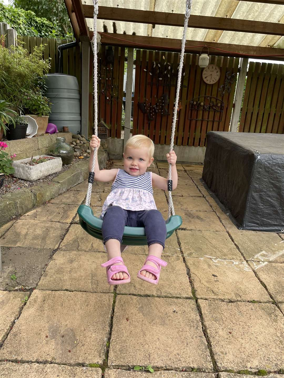 Ada playing on a swing now her isolation is over (50259080)