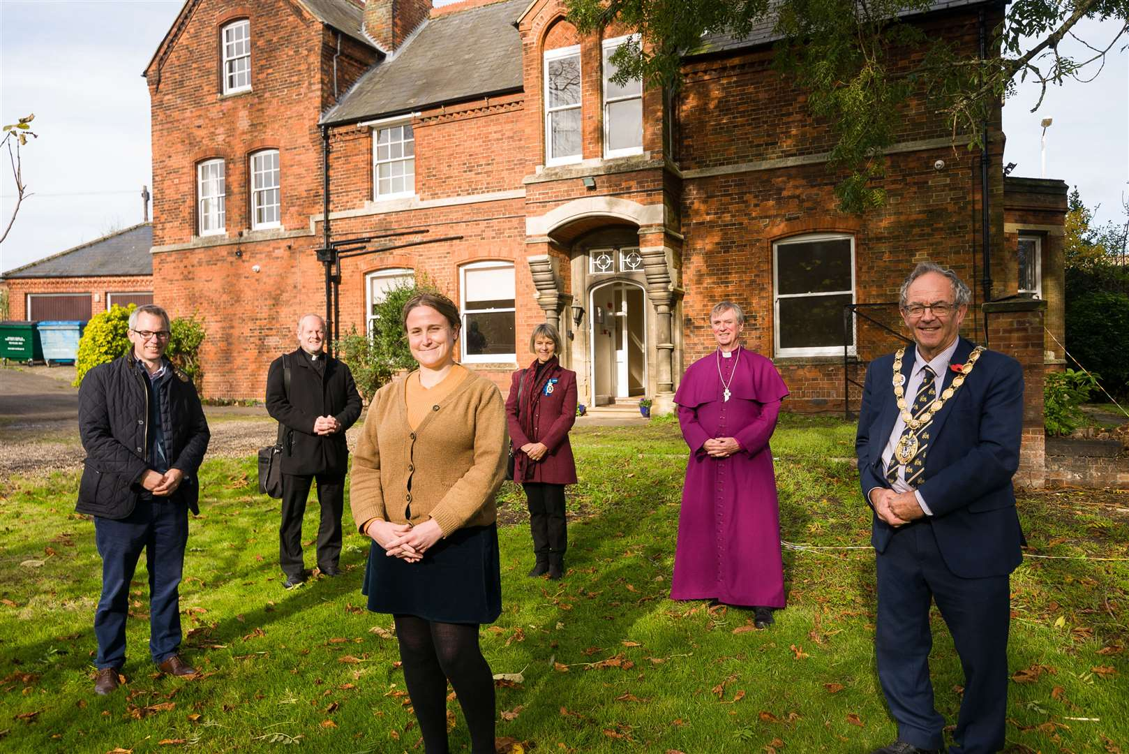 At the official opening of the Night Shelter are (from left) James Wild MP, Father Adrian Ling, co-ordinator Lucy McKitterick, High Sheriff of Norfolk, Georgina Roberts, the Bishop of Lynn, Rt Revd Jonathan Meyrick and borough Mayor, Geoff Hipperson.. (50660350)